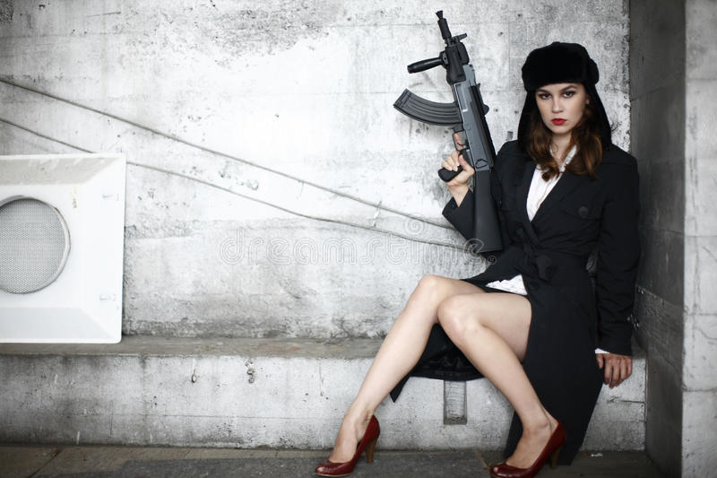 Stylish woman with rifle royalty free stock images