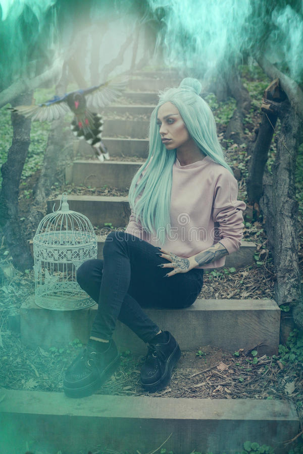 Stylish woman sitting on the old stairs. stock photography