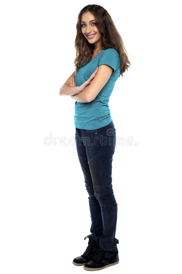 Download Stylish Woman Standing Sideways With Arms Crossed Stock Image - Image of isolated, jeans: 28797233