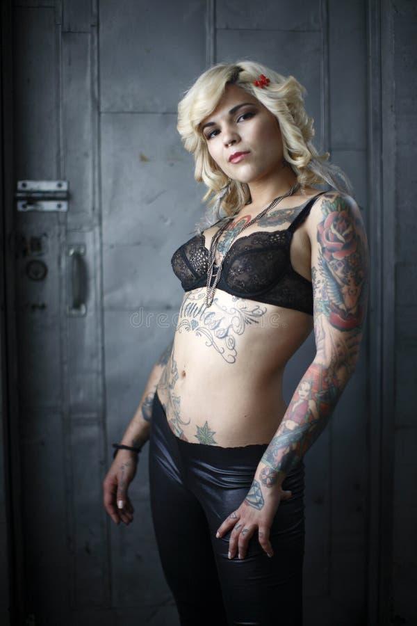 Stylish woman with tattoos stock photos