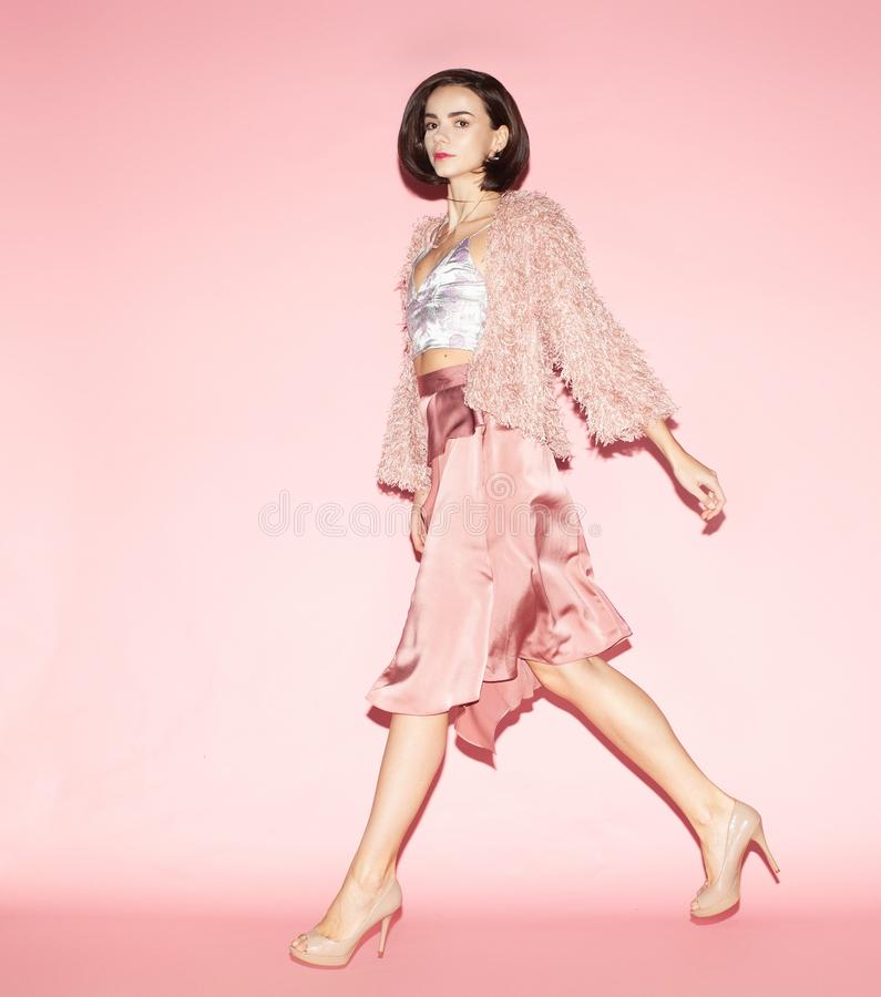 Stylish woman in total pink stock images