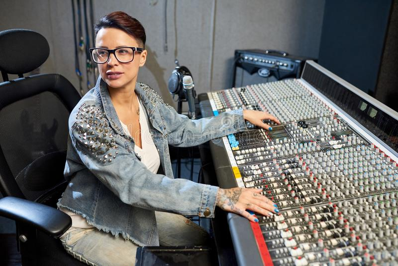 Professional woman in sound studio royalty free stock images