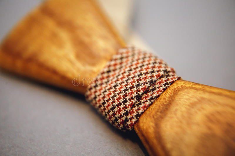 Stylish wooden bowtie soft cloth ribbon. Classic groom accessories. Set of men`s stylish vintage wooden. Male decoration for couple. Jewelry for man. Groom`s stock photography