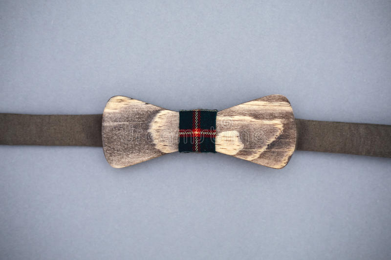 Stylish wooden bowtie soft cloth ribbon. Classic groom accessories. Set of men`s stylish vintage wooden. Male decoration for couple. Jewelry for man. Groom`s stock photo