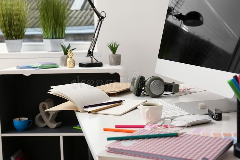 Stylish workplace of designer with modern computer stock images