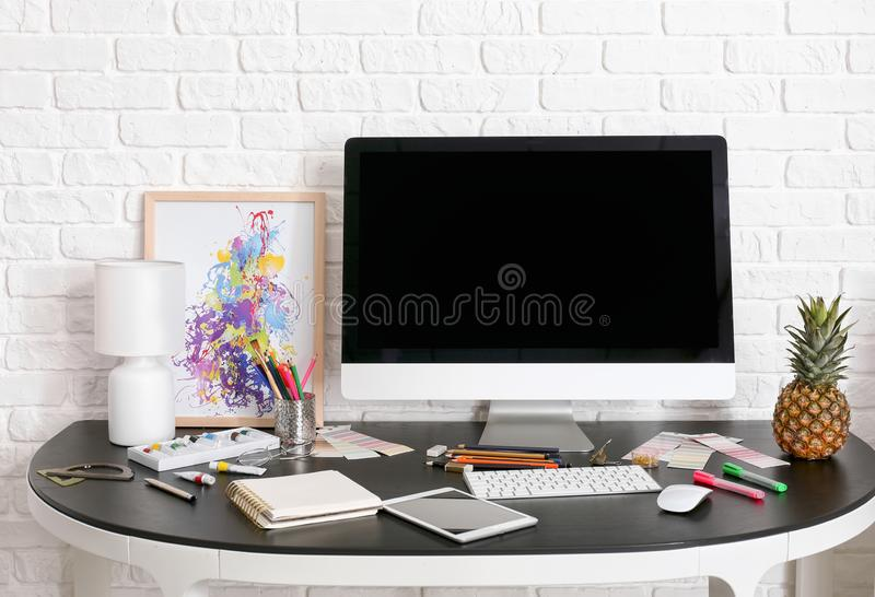 Stylish workplace of designer with modern computer stock photo