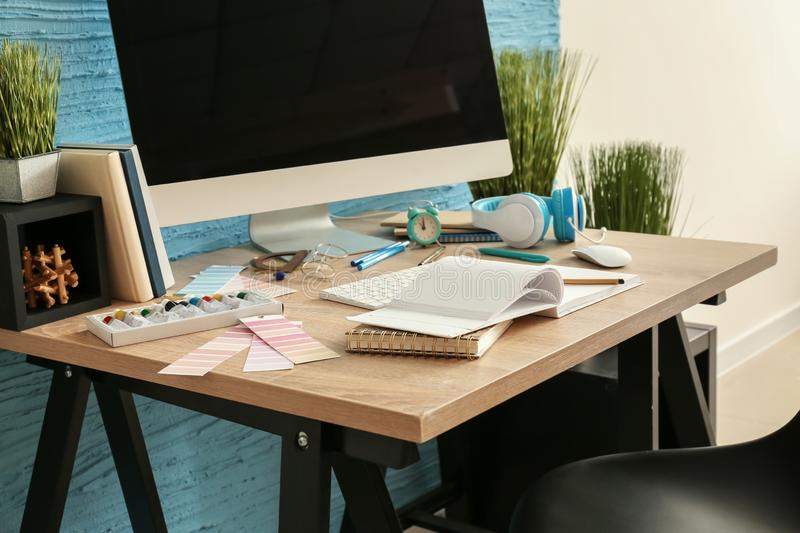 Stylish workplace of designer with modern computer royalty free stock photo