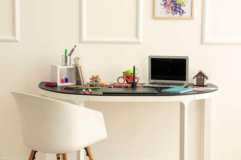 Stylish workplace of designer with modern laptop royalty free stock images