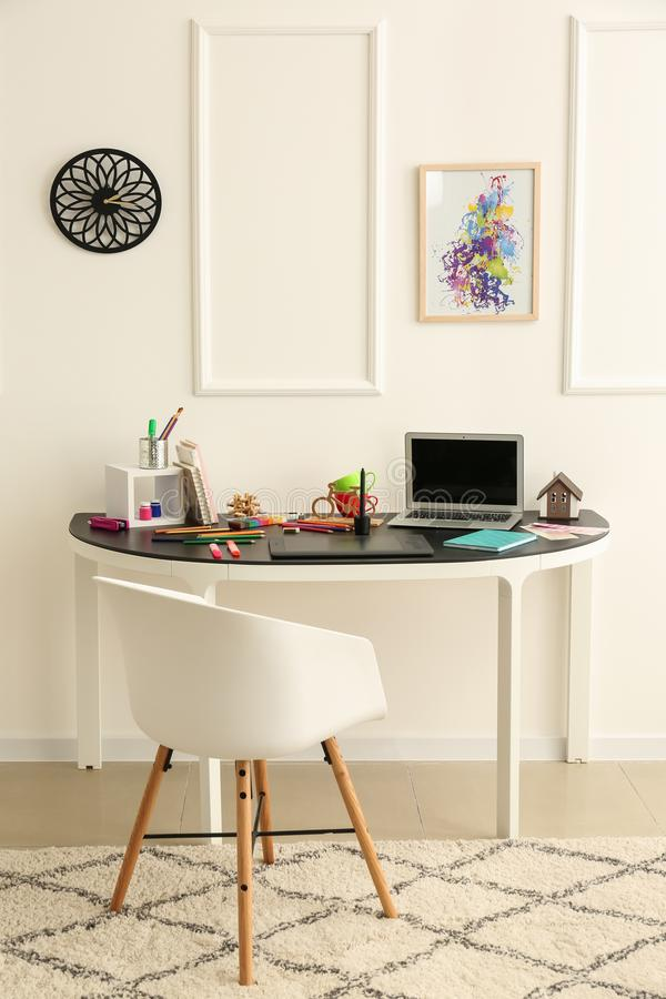 Stylish workplace of designer with modern laptop stock photography