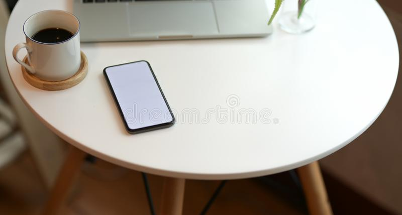 Stylish workspace with blank screen smartphone stock images