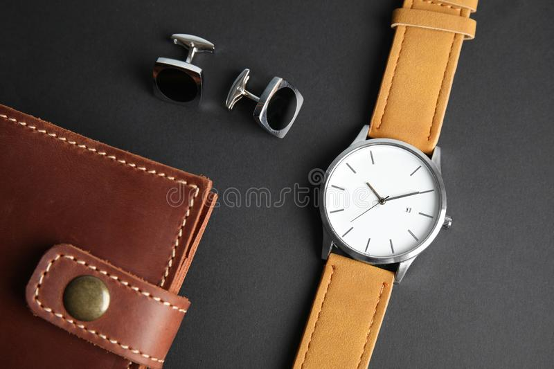 Stylish wrist watch, cuff links and wallet on black. Fashion accessory. Stylish wrist watch, cuff links and wallet on black background. Fashion accessory stock photos