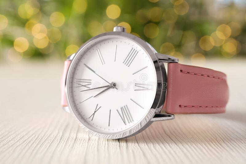 Stylish wrist watch on light table. Fashion. Accessory stock images