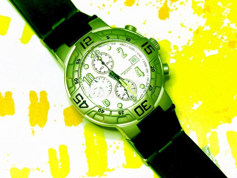 Stylish Wrist Watch on Patterned Yellow Background royalty free stock image