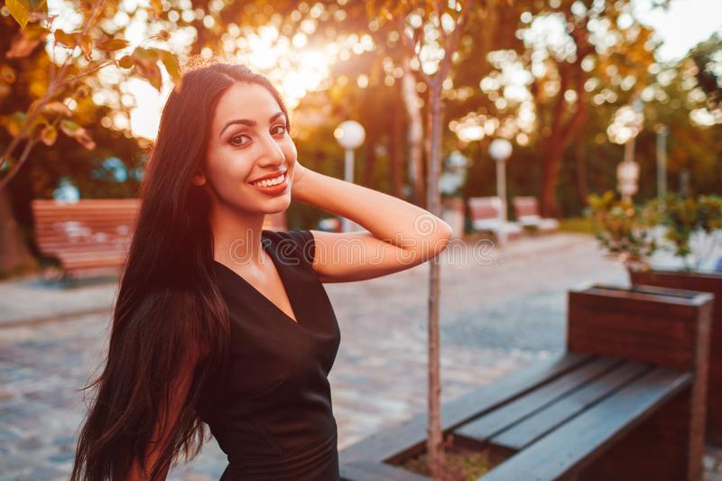 Stylish young business woman chilling in summer park. Fashionable outfit. Happy beautiful model smiling at camera stock images
