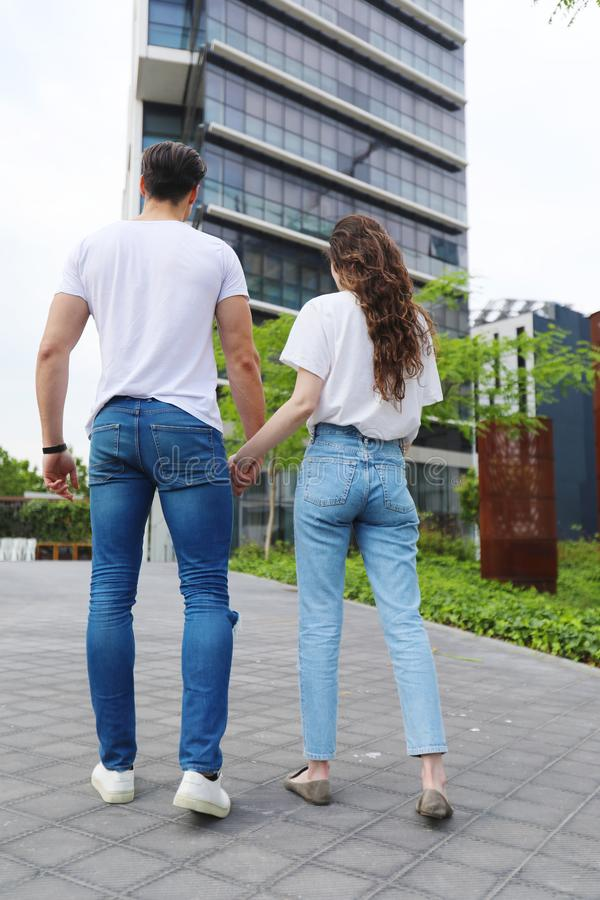 Young beautiful couple posing wearing jeans and t-shirt stock images