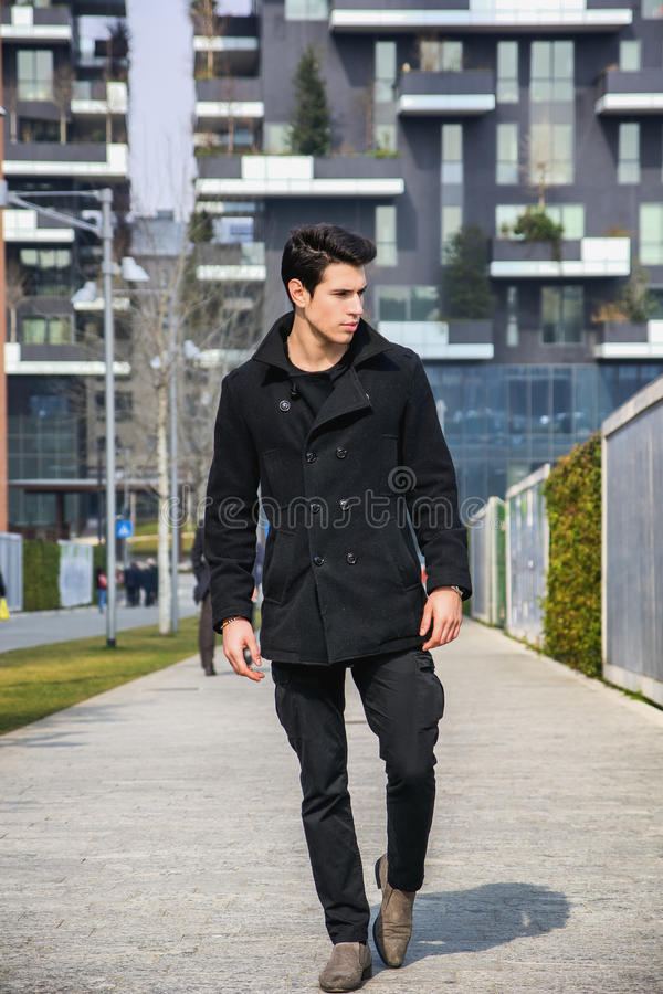Stylish Young Handsome Man in Black Coat Standing in City Center stock image