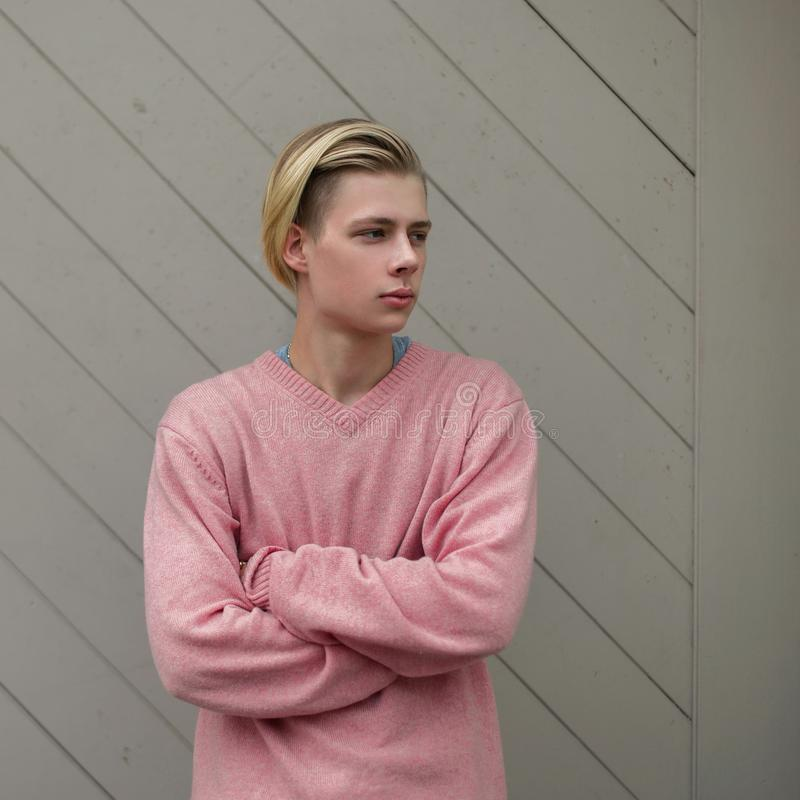 Stylish young handsome man with a blond hairstyle royalty free stock image