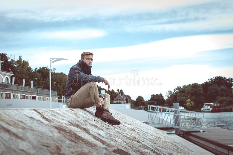 Stylish young handsome man stock photos