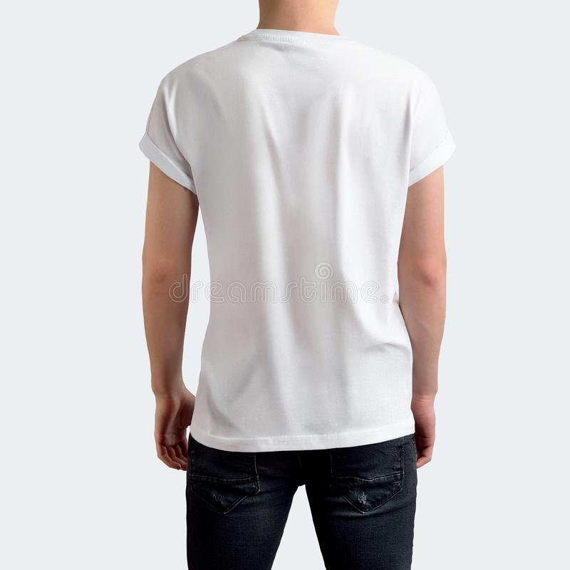 Stylish young man in blank white t-shirt and black jeans on a white blank studio background royalty free stock photos