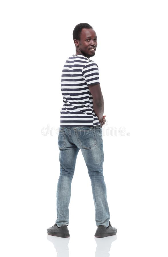 Stylish young man looking back. isolated on white. Rear view. stylish young man looking back. isolated on white background royalty free stock photography