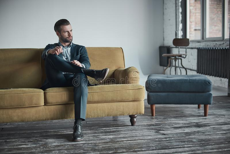 Stylish young man in a suit and bow tie. Business style. Fashionable image. Evening dress. man standing and looking at the camera. Fashion look royalty free stock images