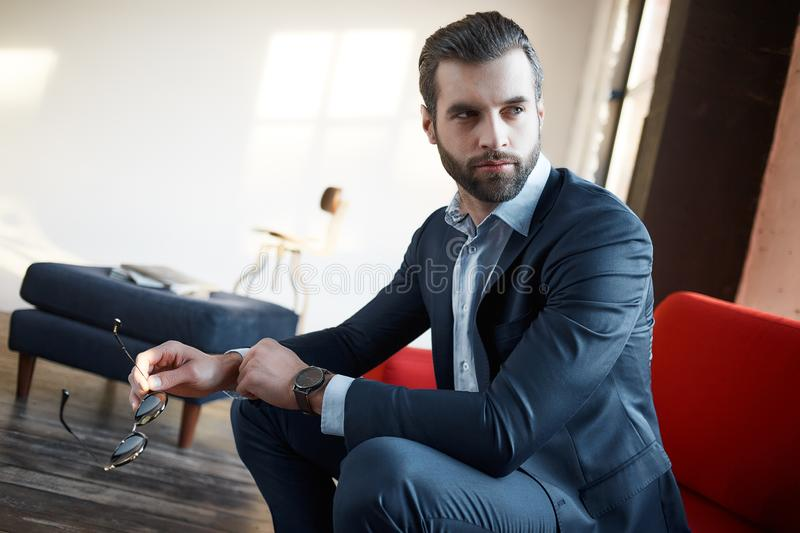 Stylish young man in a suit and bow tie. Business style. Fashionable image. Evening dress. man standing and looking at the camera. Fashion look royalty free stock photos