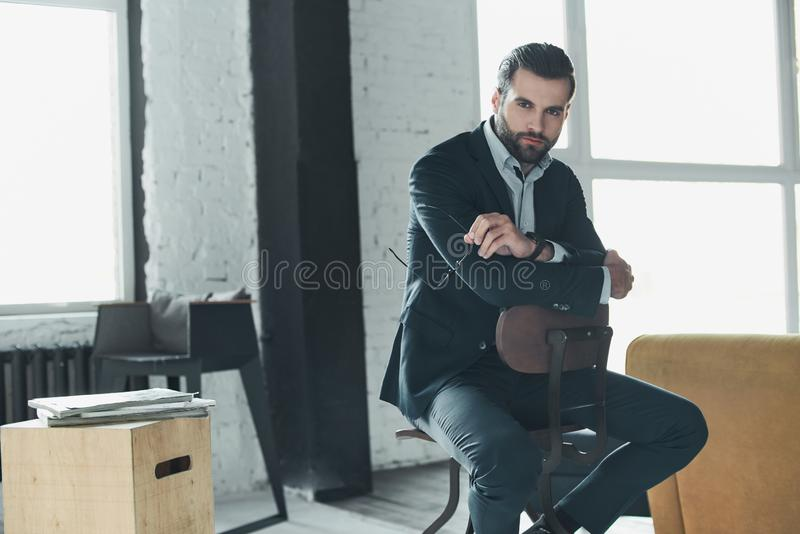 Stylish young man in a suit and bow tie. Business style. Fashionable image. Evening dress. man standing and looking at the camera. Fashion look royalty free stock photography