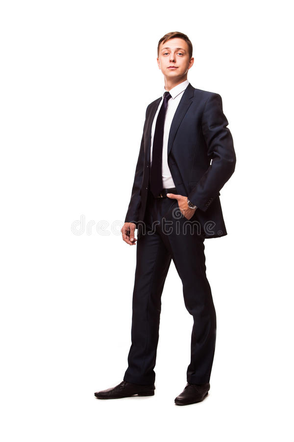 Stylish young man in suit and tie. Business style. Handsome man standing and looking at the camera royalty free stock photos