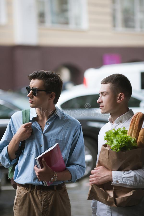 Stylish young men shopping. Hipster youth stock photography