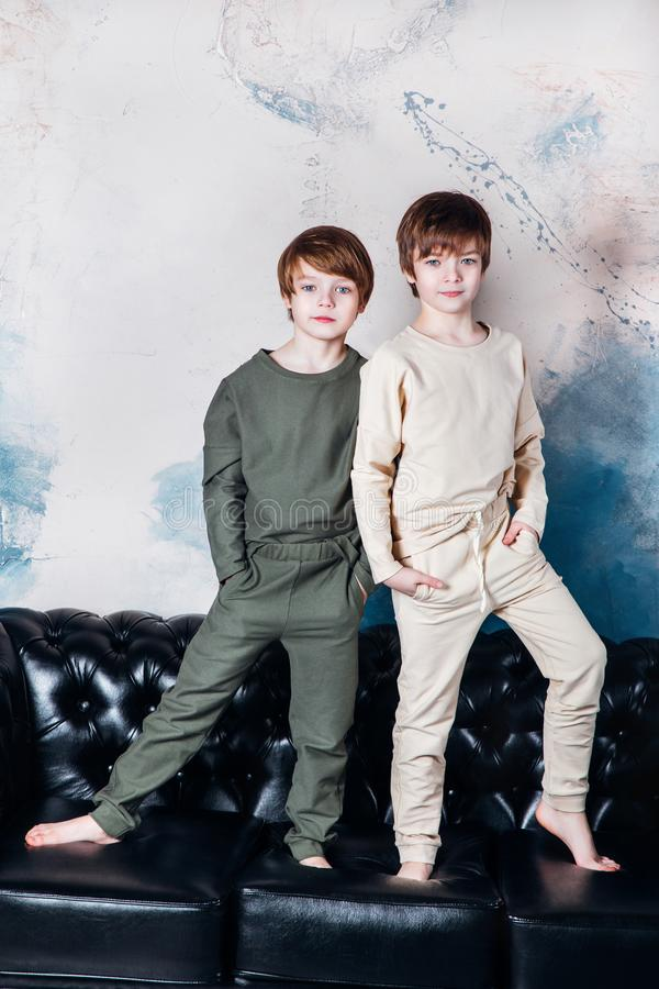 Stylish young teen posing at studio. Kids fashion concept. royalty free stock image