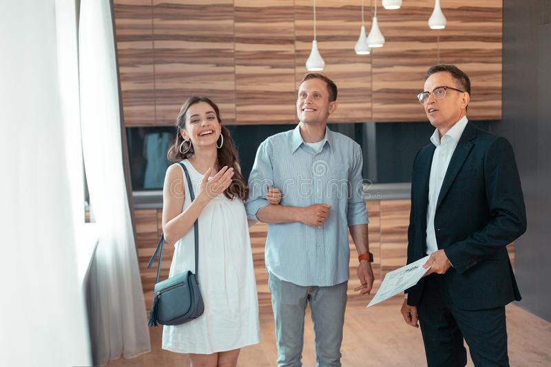 Stylish young wife smiling choosing house with husband stock photography