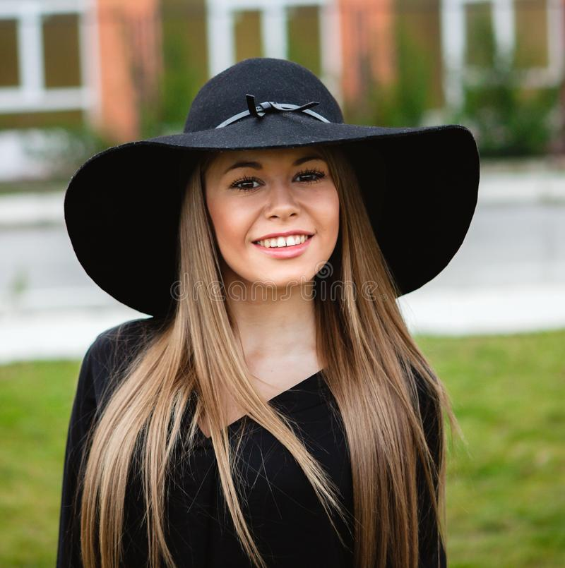 Stylish young woman with beautiful hat royalty free stock photos