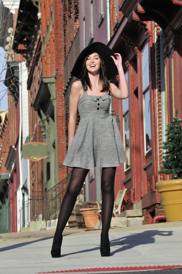 Stylish young woman in the city stock photo
