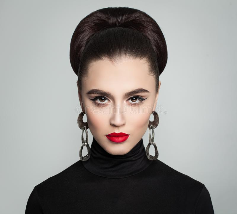 Stylish Young Woman with Hair Bun Hairdo royalty free stock photos