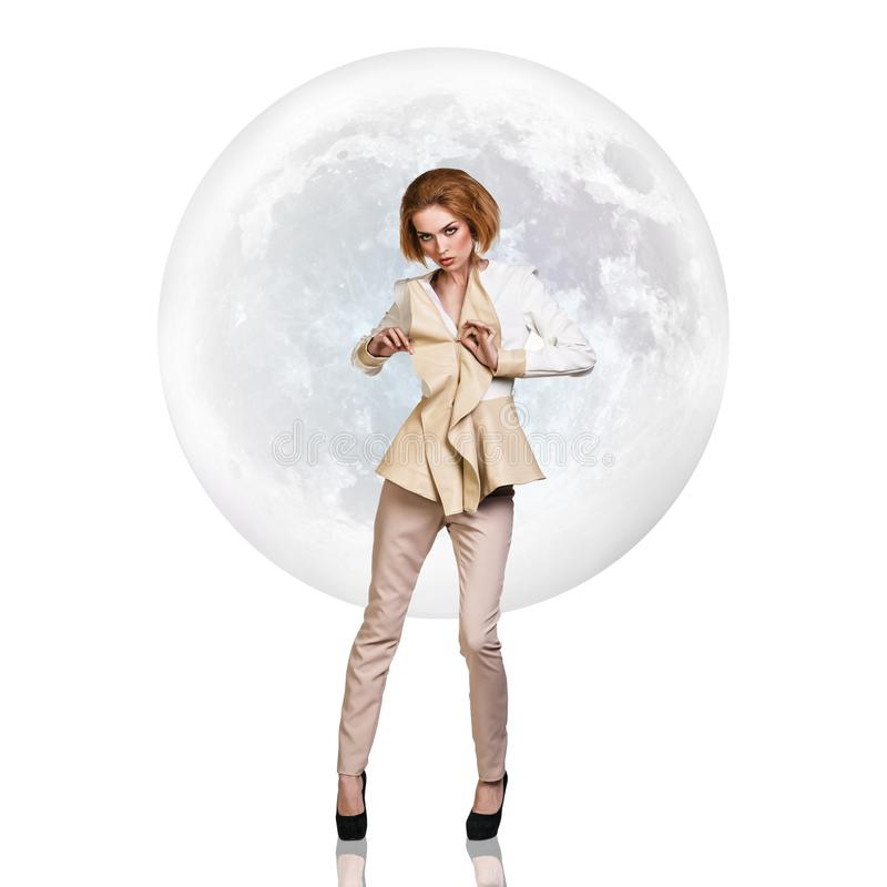 Stylish young woman over full moon background. royalty free stock image