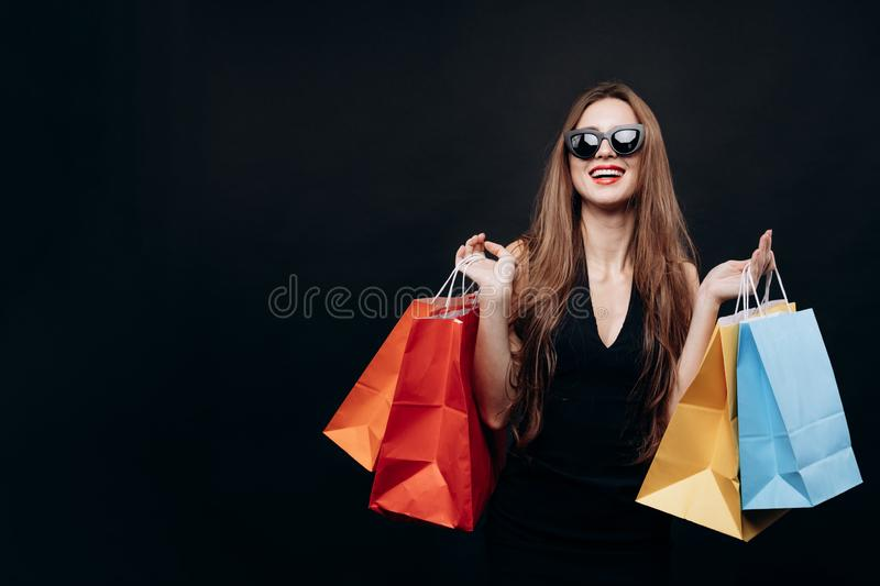 Stylish Young Woman Posing With Bags of Trendy Purchases royalty free stock images