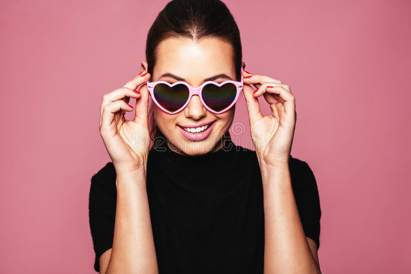 Stylish young woman posing with funky shades stock photos