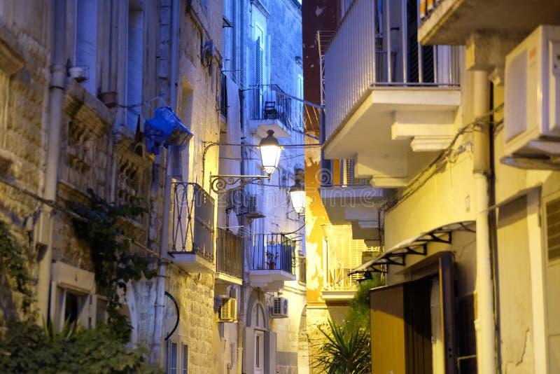 Stylized antique lantern to illuminate. The narrow streets of the old city. Italy stock photo