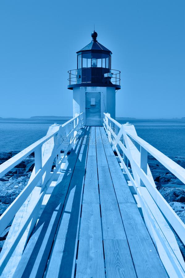 Stylized blue hour image of Marshall Point Lighthouse, Maine, in classic blue 2020 color of the year, symbol of calm, peace, and stock photos