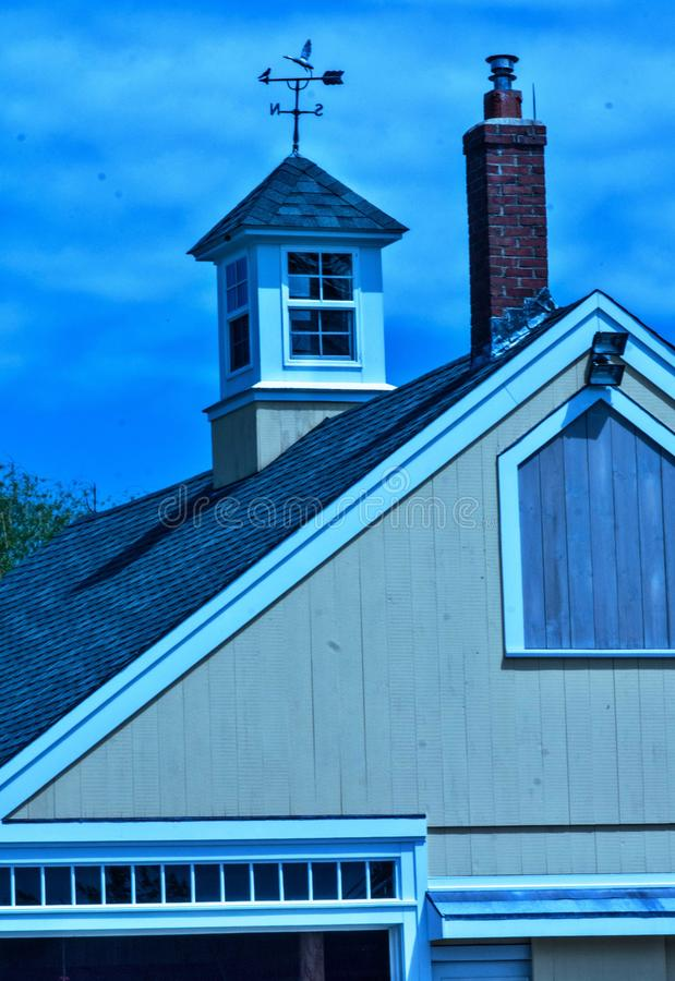 Stylized blues and yellow barn image with cupola and weathervane royalty free stock image