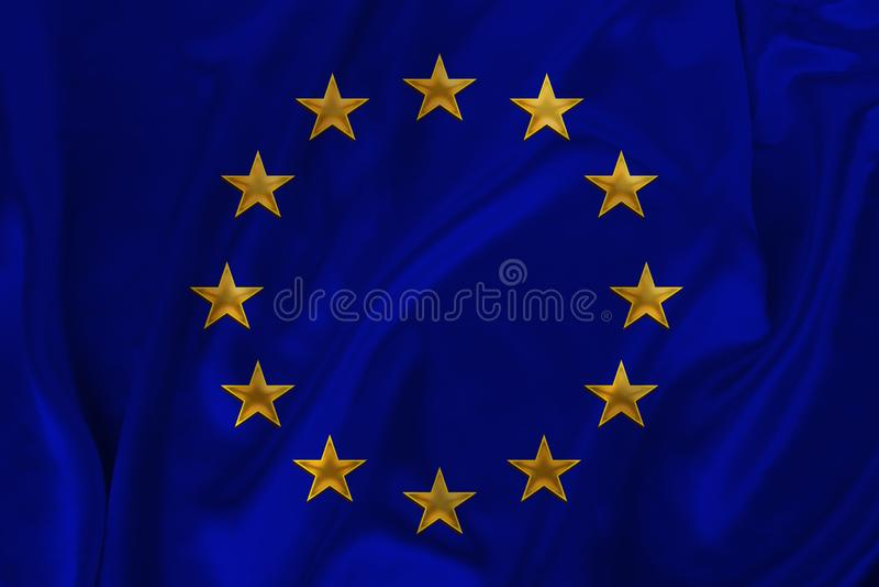 Stylized European Union flag, symbol of united Europe on soft silk with soft folds, close-up royalty free stock images