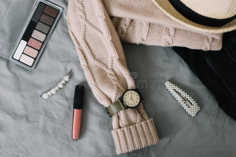 Stylish feminine accessories. Women clothing, hair clips, cosmetics. Beauty  fashion blog concept. top view. Stylized feminine flatlay with lipstick, watch royalty free stock image