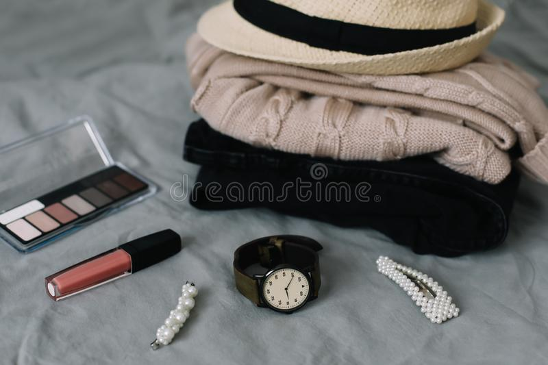 Stylish feminine accessories. Women clothing, hair clips, cosmetics. Beauty  fashion blog concept. top view. Stylized feminine flatlay with lipstick, watch stock photography