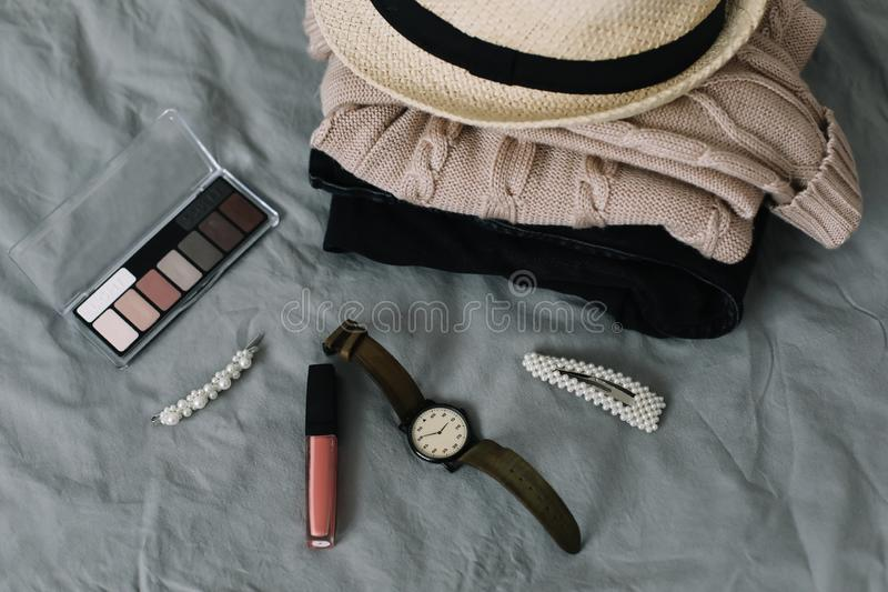 Stylish feminine accessories. Women clothing, hair clips, cosmetics. Beauty  fashion blog concept. top view. Stylized feminine flatlay with lipstick, watch stock photo
