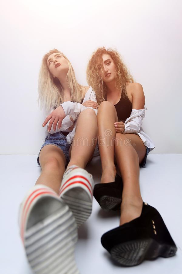 Two girls of a friend sitting next to each other. Stylized image of two girls of a friend sitting next to each other royalty free stock images