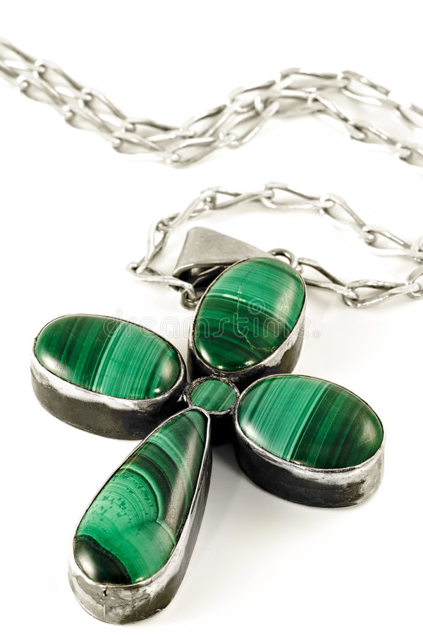 Stylized malachite fourleafed clover. Stylized under fourleafed clover female ornament gem-malachite cross on a silver chain royalty free stock photo