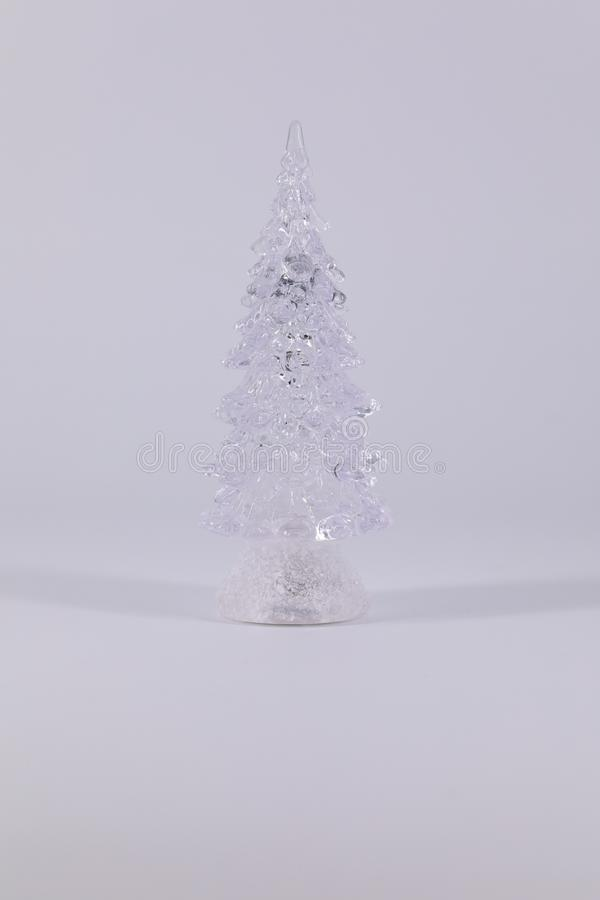 Stylized Christmas tree made of transparent material on a dark and light background. stock photo