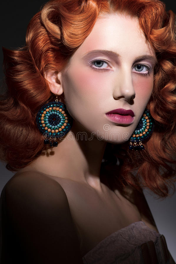 Stylized portrait of young beautiful red haired woman stock images