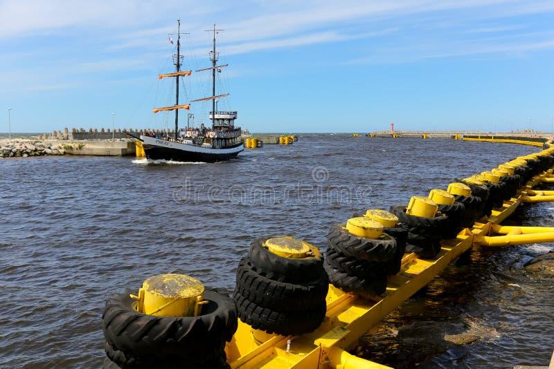 Stylized ship called Pirat returns from a cruise. Kolobrzeg, Poland - June 20, 2017: Stylized ship called a Pirat returns from a cruise. The ship is seen in the royalty free stock photography