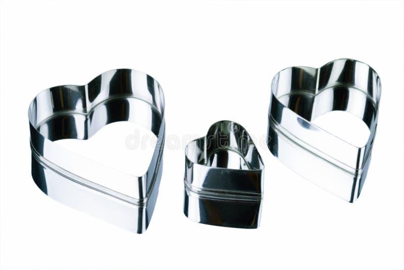 Stylizowani metali serca różni rozmiary pojedynczy białe tło obrazy stock